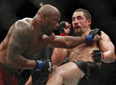 Robert Whittaker, right, and Yoel Romero fight during their middleweight bout at the UFC 225.