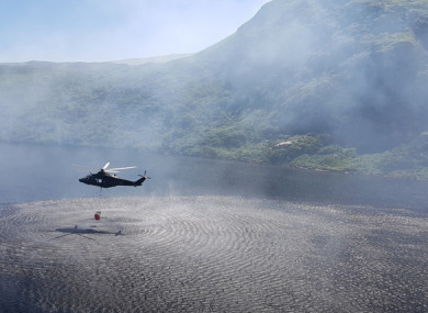 An Air Corps helicopter picking up water to help with firefighting last week.