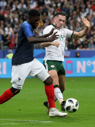 Ireland's Alan Browne challenging Samuel Umtiti of France.