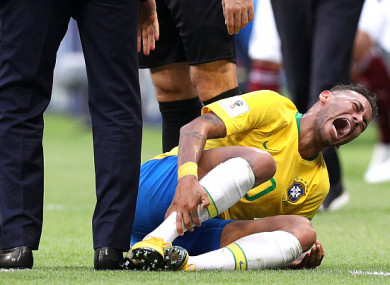 Neymar injured during Brazil's World Cup last 16 clash against Mexico.