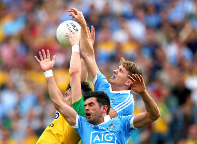Dublin and Donegal players battle for aerial possession.