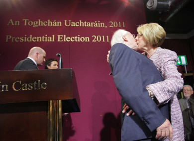 Higgins and wife Sabrina embrace after he is officially made president in 2011.