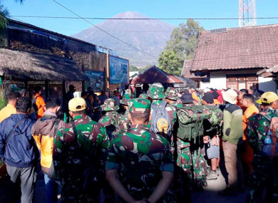 Indonesian soldiers and rescue team gather to prepare for evacuating tourists from Mount Rinjani today.