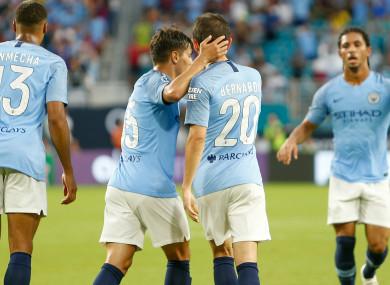 Bernardo Silva celebrates with his Manchester City team-mates.
