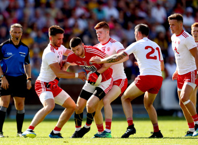 The Tyrone defence apply the pressure on Cork's Luke Connolly.