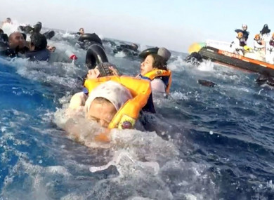 Refugees being rescued by the Italian Coast Guard after a boat capsized in the Mediterranean Sea in April.