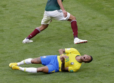 Neymar reacts to a challenge during today's Brazil-Mexico game.