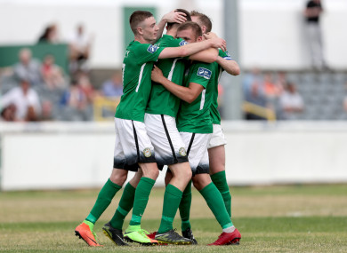 Sean Heaney celebrates with teammates after scoring a second-half winner.