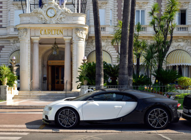 A Bugatti Chiron, casually parked outside a luxury hotel