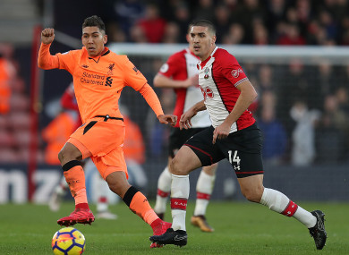 Southampton's Oriol Romeu (right) and Liverpool's Roberto Firmino (left) battle for the ball.