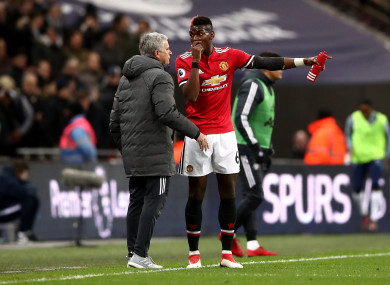 Manchester United manager Jose Mourinho (left) and Paul Pogba talk on the touchline.