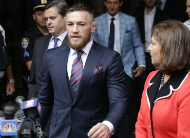 Conor McGregor exits the courthouse yesterday