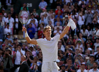 Kevin Anderson celebrates his win against Roger Federer.