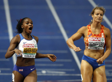Asher-Smith celebrates as she crosses the line in Berlin.