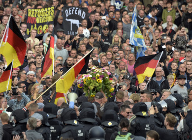 Protesters carry a wreath as they gather for a far-right protest in Chemnitz, Germany