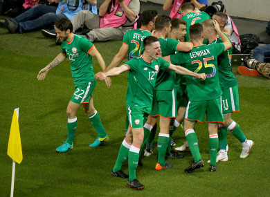 Ireland players celebrate a goal against USA.