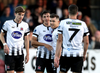Dundalk's Jamie McGrath celebrates scoring a goal with team-mates.
