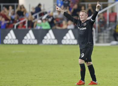 DC United forward Wayne Rooney (9) celebrates after scoring.