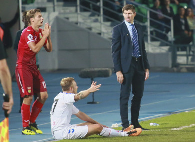 Rangers' head coach Steven Gerrard, right, Rangers' Scott Arfield, centre, Ufa's Dmitri Zhivoglyadov react during the Europa League play-off round.