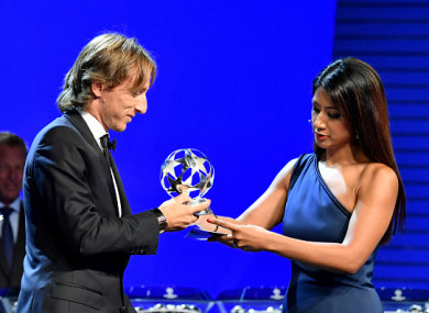 Modric receives his award at this evening's ceremony in Monaco.