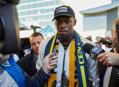 Jamaican sprint legend Usain Bolt is seen as he arrives at Sydney Airport.