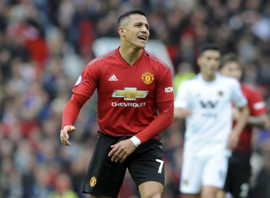 Alexis Sanchez reacts during the English Premier League soccer match between Manchester United and Wolverhampton Wanderers at Old Trafford.