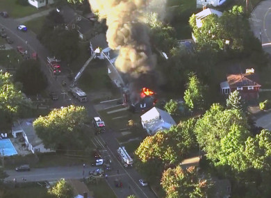 Firefighters battle a raging house fire in Lawrence, Massachusetts, a suburb of Boston.