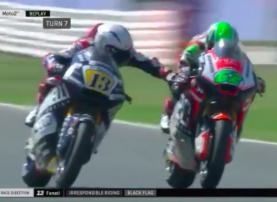 Romano Fenati (left) reaches across his opponent.