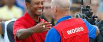 Woods celebrates with his caddie Joe LaCava.