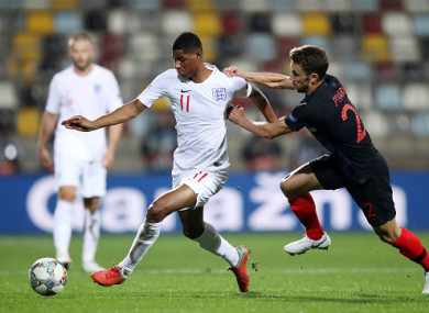 Rashford gets away from Croatia's Josip Pivaric.