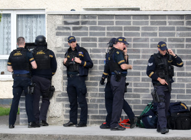 Members of Garda armed support units at the house.