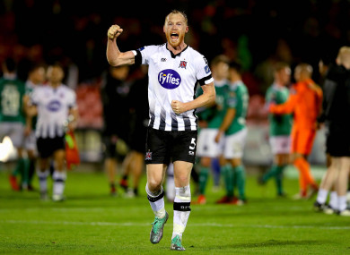 Shields punches the air after beating Cork City at Turner's Cross.