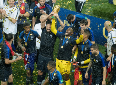 France players celebrate with the World Cup trophy.