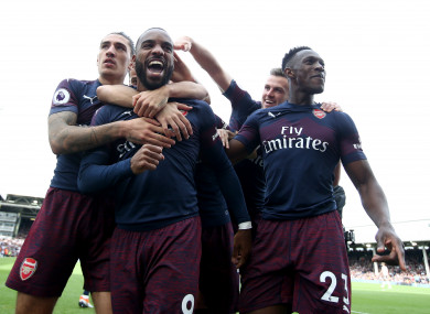 Arsenal players celebrate Alexandre Lacazette's second goal.