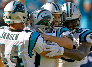 Graham Gano is congratulated after his 63-yard field goal.