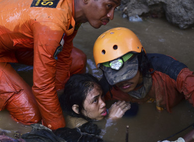 Rescuers save a 15-year old earthquake victim in Sulawesi, Indonesia.