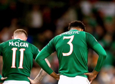 Ireland's James McClean and Cyrus Christie dejected at the final whistle.