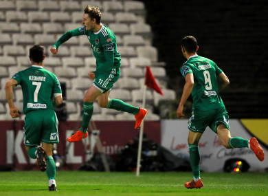 Sadlier (centre) celebrating a goal (file photo).