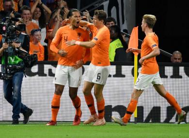 Virgil van Dijk celebrates scoring for the Netherlands on Saturday night.