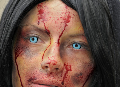 File photo of a woman in costume wearing cosmetic contact lenses