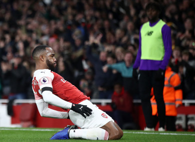 Lacazette celebrates his brilliant finish.