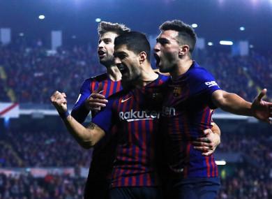 Barca celebrate Suarez's late strike.