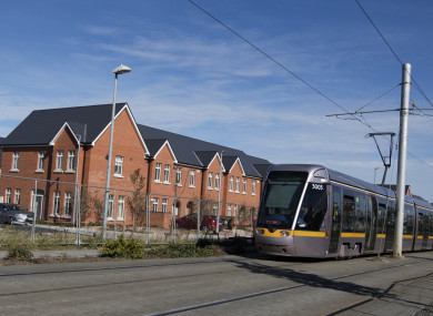 The Luas passing houses on a construction site in City West, Dublin