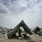 Pakistani flood survivors live in a camp set up for displaced people in Sukkar, Pakistan, on 14 August, 2010.<span class=