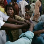 Pakistani flood victims fight with each others for a food relief distributed by volunteers in Pakistan.<span class=