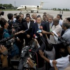 U.N. Secretary-General Ban Ki-moon, center with glasses, talks to media upon his arrival at Chaklala airbase in Rawalpindi, Pakistan on Sunday, Aug. 15, 2010. U.N. Secretary-General Ban Ki-moon travelled to flood-ravaged Pakistan on Sunday to boost relief efforts as the 20 million people made homeless in one of the worst disasters to hit the country grew increasingly desperate.<span class=