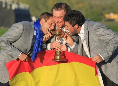 Sergio Garcia, left, Miguel Angel Jimenez, center, and Jose Maria Olazabal celebrate with the trophy