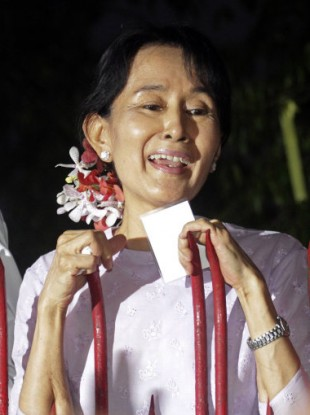 Aung San Suu Kyi speaks to supporters outside her home on Saturday 13 November
