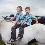 Two boys pose at the horse fair event at the Puck Fair in Killorglin, Co Kerry, the oldest traditional fair in Ireland.<span class=