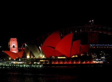 Sydney Opera House is bathed in red to launch World Aids Day.